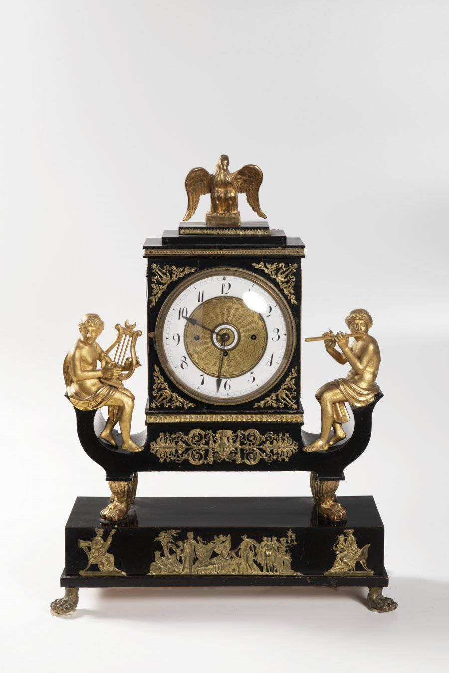 AN EMPIRE CLOCK WITH MUSIC BOX
