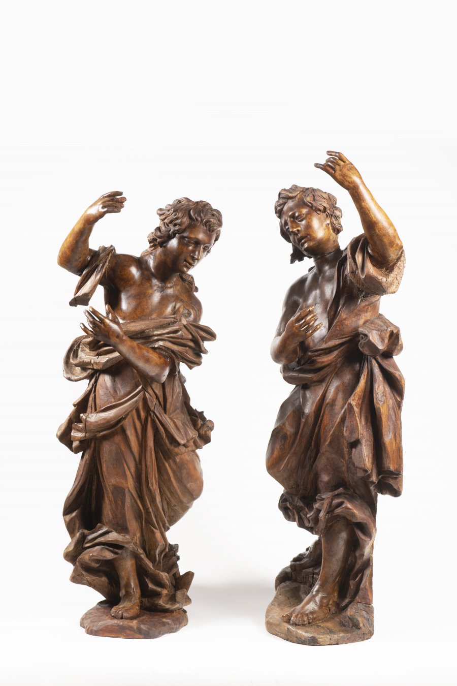 A PAIR OF WOODEN STATUES