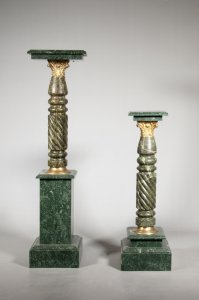 PAIRED COLUMN SHAPED PEDESTALS