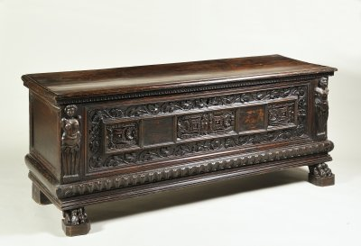 A CARVED WALNUT CHEST