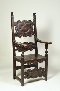 A CARVED WALNUT CHAIR