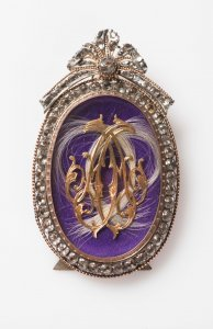 A MINIATURE WITH A MONOGRAM